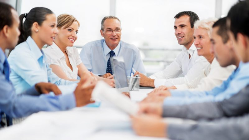 Successful group of businesspeople on a meeting discussing.   [url=http://www.istockphoto.com/search/lightbox/9786622][img]http://dl.dropbox.com/u/40117171/business.jpg[/img][/url]